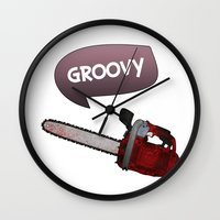 evil dead Wall Clocks featuring Evil dead Groovy chainsaw by Komrod