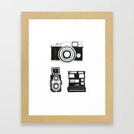 Three cameras. Framed Art Print