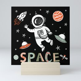 Space Astronaut and Flying saucers Mini Art Print