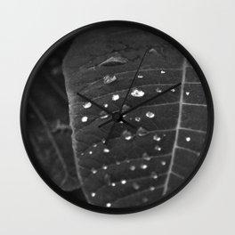 Shining Rain drops on a poinsettia leaf Wall Clock
