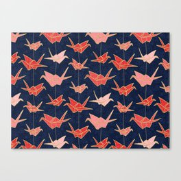 Red origami cranes on navy blue Canvas Print