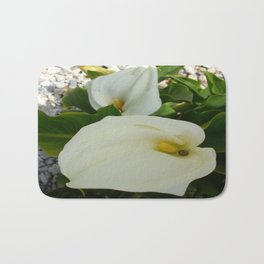 Overhead View Of Two Calla Lilies In A Garden Bath Mat