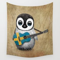 swedish Wall Tapestries featuring Baby Penguin Playing Swedish Flag Guitar by Jeff Bartels