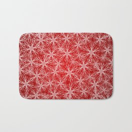 Snowflakes pattern on red background Bath Mat