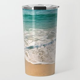 Sandy beach at noon with blue water and clear sky Travel Mug