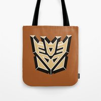 transformers Tote Bags featuring Transformers by FilmsQuiz