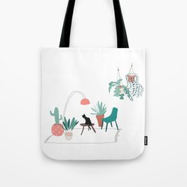 Cat relaxing in the living room among plants Tote Bag