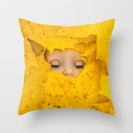 Moody, sleeping doll in vibrant yellow maple leaves Throw Pillow