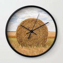 Side on look at round hay bale near Wagin, Western Australia Wall Clock