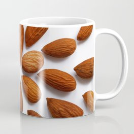 pattern from almonds seeds on a white background Coffee Mug