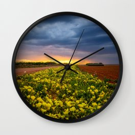 Yellow Flower Road - Path of Wildflowers Lead Into Texas Sunset on Stormy Evening Wall Clock