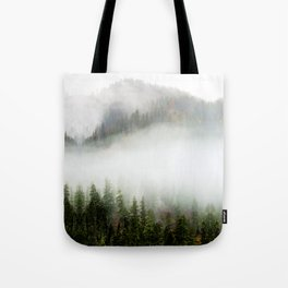 peaceful foggy day forest landscape photography Tote Bag