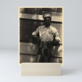 Doris Ulmann  (1882–1934), Black man in hat, shirt with rolled-up sleeves, and patched pants, leanin Mini Art Print