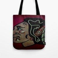 blackhawks Tote Bags featuring Blackhawks by Jide