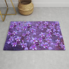 purple orchids on a textured wall Rug