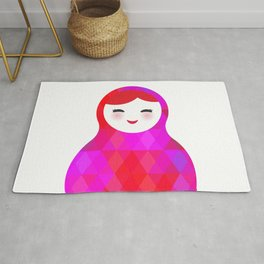 Russian doll matryoshka screw up one's eyes with bright rhombus on white background, pink colors Rug