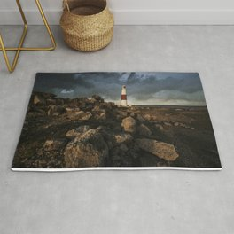 Red And White Lighthouse at sunset Rug