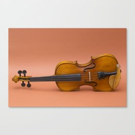 violin on a brown background Canvas Print