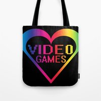 video games Tote Bags featuring love video games by seb mcnulty