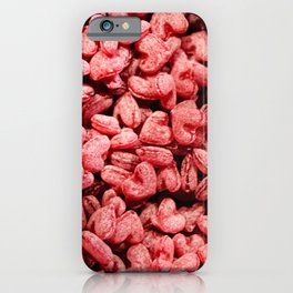 Pink candies in heart shape background iPhone Case