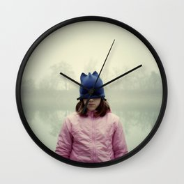 Sad girl with eyes covered by cap. Wall Clock