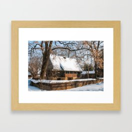 Old Romanian Cottage covered in snow Framed Art Print