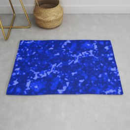 A chaotic cluster of blue bodies on a light background. Rug