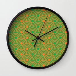 op art pattern retro circles in green and orange Wall Clock