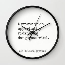 A crisis is an opportunity riding the dangerous wind. Wall Clock