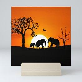 Elephant silhouettes at sunset Mini Art Print