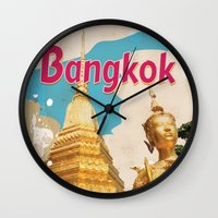 travel poster Wall Clocks featuring Bangkok Vintage Travel Poster by Nick's Emporium Gallery