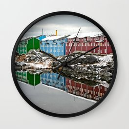 Colourful buildings mirroring in lake Wall Clock