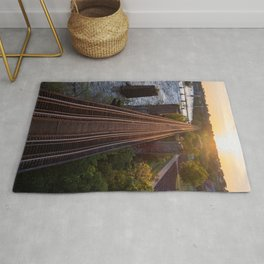 Setting Sun Over The Tracks Rug