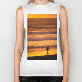 Surfer walking along beach at sunset Biker Tank