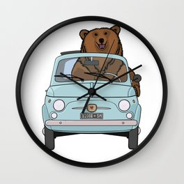 A smiling bear driving a small light blue car Wall Clock