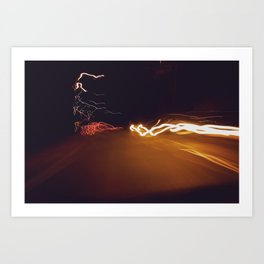 City at night, streets buzzing, car lights blurring Art Print