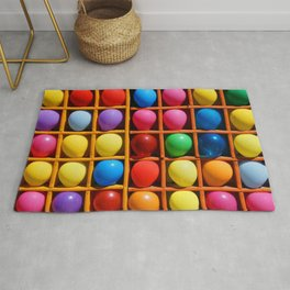 colorful balloons in wooden boxes, attraction Rug