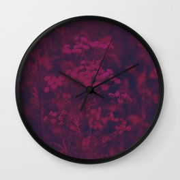 Photograph of wild and wild plants in the field beside the river, in warm color and intense pink Wall Clock