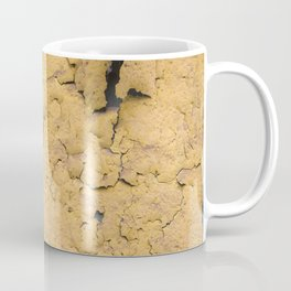 Flaked yellow paint on green surface Coffee Mug