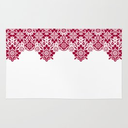 Retro .Vintage . Red lace on a white background . Rug
