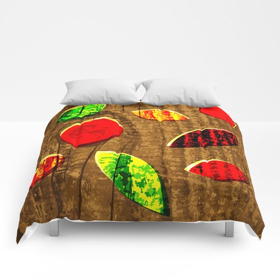 colored leafs on wood Comforters