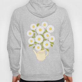 bouquet of camomiles in the vase on the black Hoody
