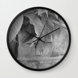 grave under leafs Wall Clock
