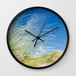 Vibrant Sand dune grasses against blue sky, Fistral Beach Wall Clock