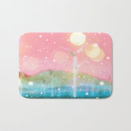 wind turbine in the desert with snow and bokeh light background Bath Mat