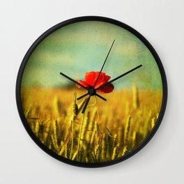 Poppy in a grain field Wall Clock