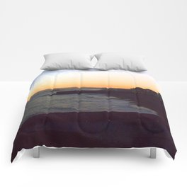 Seafront sunset Comforters