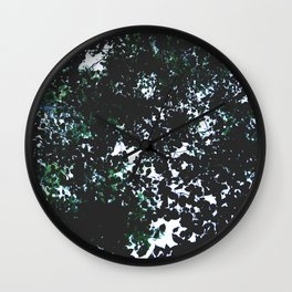 Tops of the leaves of trees silhouettes. Wall Clock