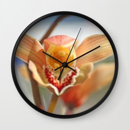 orchid flower ready to fly Wall Clock