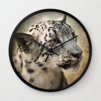 snow leopard Wall Clocks featuring Snow Leopard by Jai Johnson